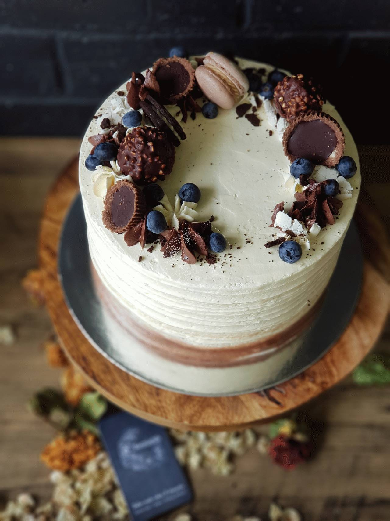 Indulgence Birthday - Vanilla textured icing with coconut sugar cookies, custom chocolate topper, blueberries and house made chocolate garnishes and macarons