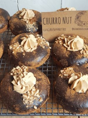 Churronut - Cinnamon donut with chocolate glaze, caramel buttercream and cinnamon dust