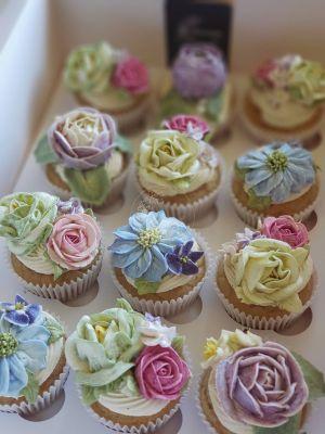Sweet Blossom standard cupcakes, vanilla cake, vanilla buttercream and mixed bouquet flowers.