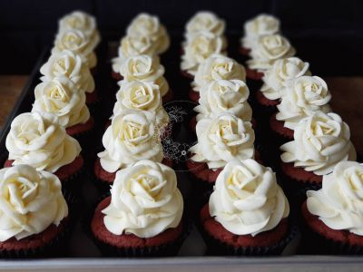 Vanilla Velvet Sweet Blossom Cupcakes - Vanilla and Beet cake, with a chocolate ganash filling and a single white rose, perfect for a wedding or special occasion.