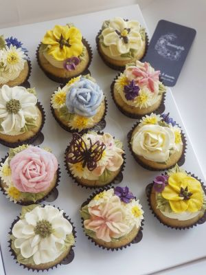 Sweet Blossom Vanilla Cupcakes, featuring roses, peonies, daisys and other assorted blossoms