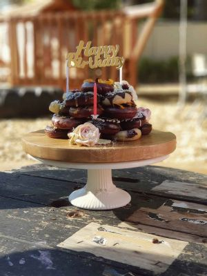 Doughnut Stack Cake, with dried fruit, buckwheat and chocolate garnishes,as well as a chocolate glaze.