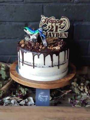 Indulgence 21st Birthday cake - Chocolate cake, vanilla buttercream, chocolate crumble and drip, custom chocolate topper and motorbike garnish.