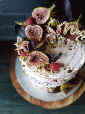 Indulgence Wedding cake, Rose water flavour and pistachios as requested, fresh figs and berries, textured icing, carved writing, chocolate leaves and supplied acrilic topper