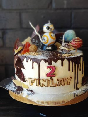 Star wars themed cake, Something Unique with chocolate drip, vanilla buttercream, bliss ball planets, Lychee. Paw Paw, chocolate shards and cookie lettering