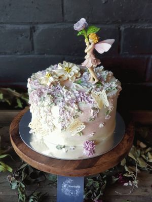 Something Unique - Fairy flower cake - Vanilla Buttercream, white choc butterflies, fairy figurine, Sweet Blossom flowers, fully iced