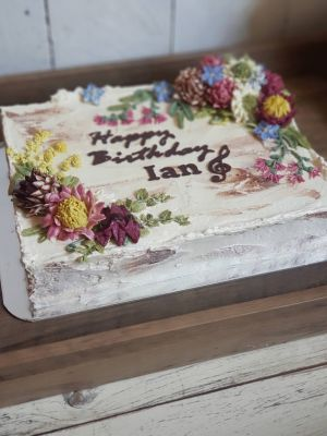 Native Sweet Blossom Slab Cake, 9x12in Slab cake with native flowers, textured icing and custom chocolate topping