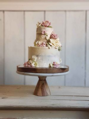 Sweet Blossom Tier Cake, select blossoms on a tier cake with textured vanilla icing