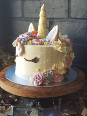 Something Unique rainbow unicorn cake - Vanilla buttercream, coconut bliss horn and ears, rosettes, coconut sugar cookies, flowers, paw paw